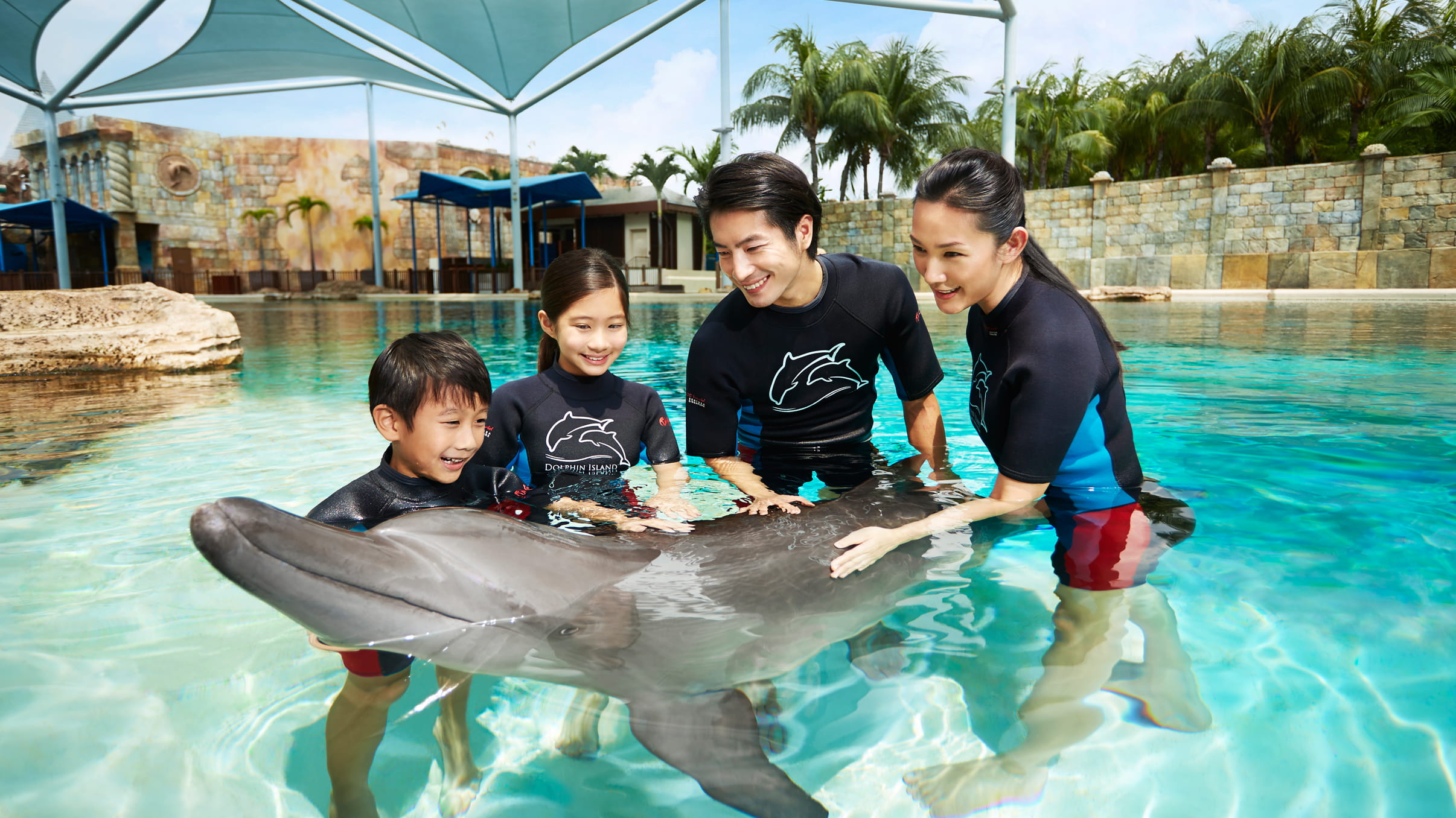 Family with dolphin at Dolphin Island